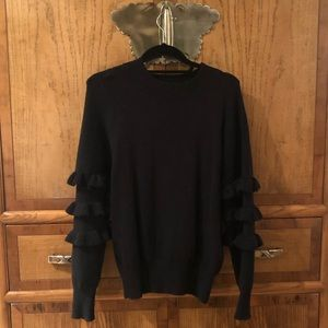 Black crew neck sweater with fringed sleeves